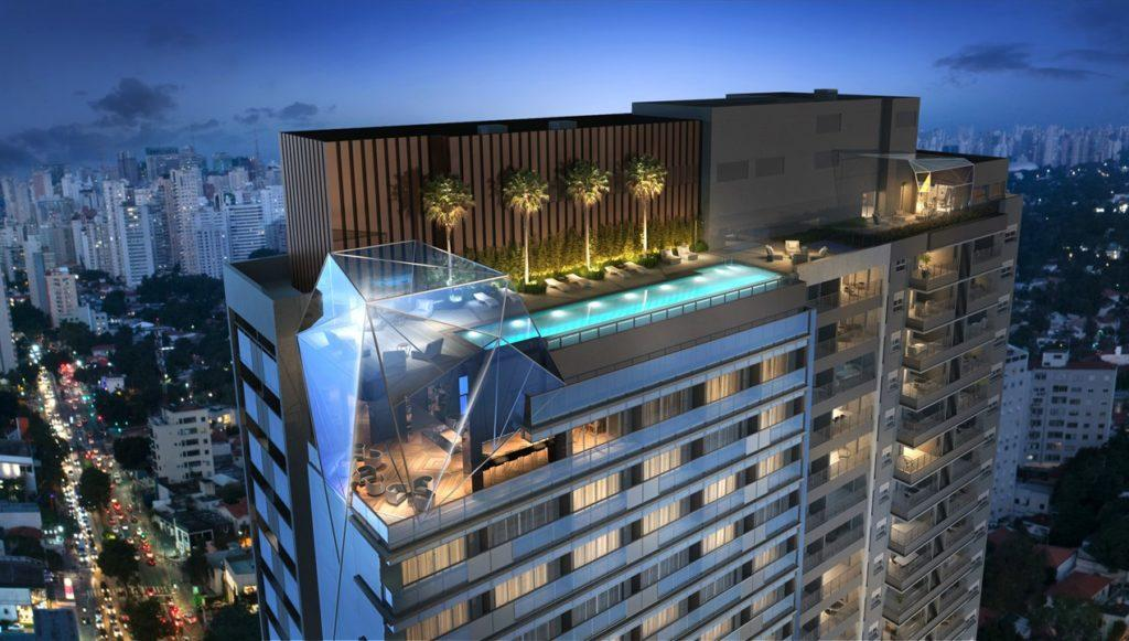 Image of a leisure space with a swimming pool. The prismatic coverage of the penultimate floor guarantees the luxury of the project.