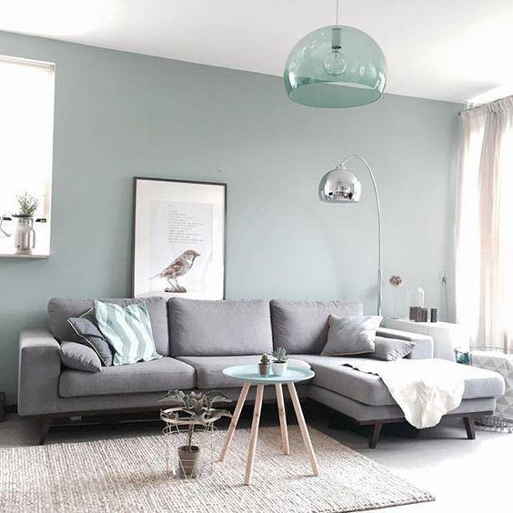 Living room decorated in shades of gray and blue and white accents.