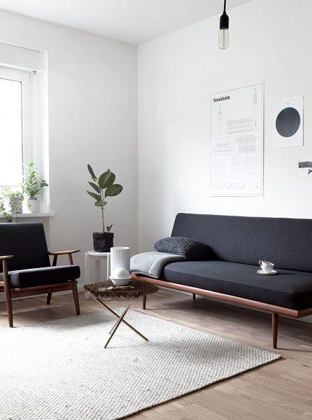 Minimalist living room where gray and white are the predominant colors.