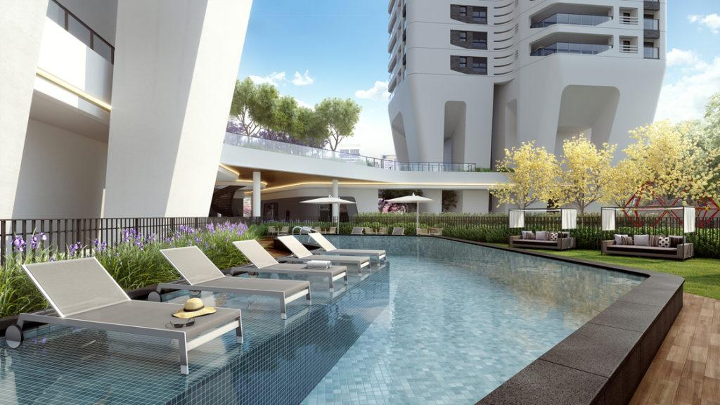 Pool area with wet deck, adjacent to residential towers with sophisticated luxury design.
